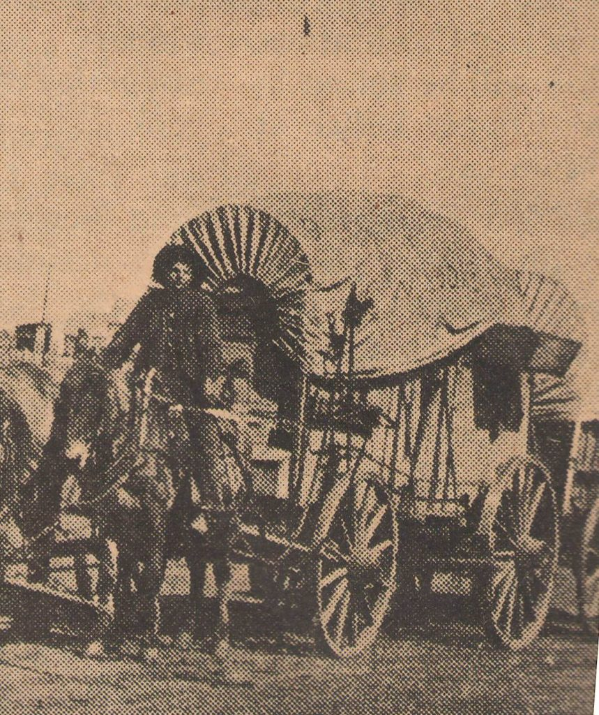 Pat Hennessey and his mule driven covered wagon on the Chisholm Trail