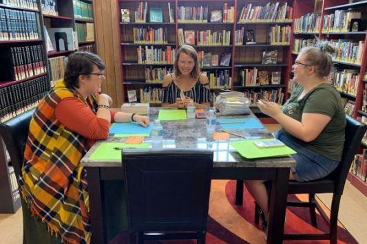 teen librarian and teens having fun at the library